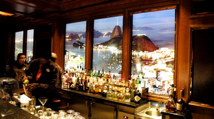 "The District, and adults only entertainment area, is home to Skyline, a bar with ""windows"" that look out onto changing city skylines. Here it's Rio de Janeiro."
