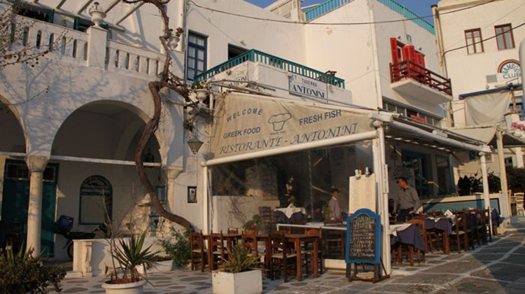 A cafe on the island of Mykonos. Its proprietor stepped into the square to pitch for business.
