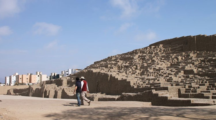 The ancient Huaca Pucllana pyramid in the middle of Lima's Miraflores district with high-rises visible in the background.