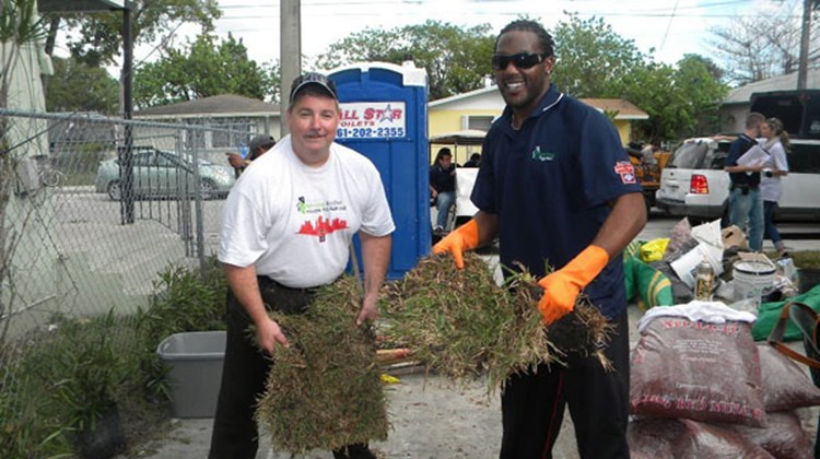 Steve Joyce, president and CEO, Choice Hotels International (left), and Brandon Jones, San Francisco 49ers, lend a hand with landscaping at Kickoff To Rebuild 2010.