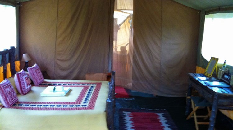 The spacious, eco-friendly interior of a two-bed, three-person tent at Gamewatchers Safaris' Porini Mara Camp.