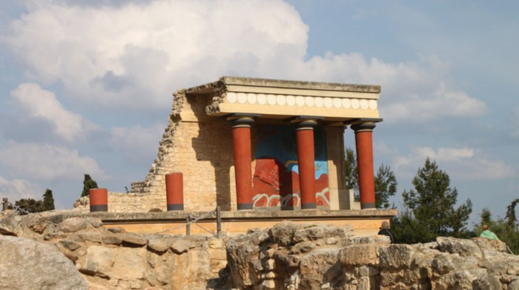 The most photographed reconstruction at Knossos Palace on Crete. The structure is called the West Bastion, one of two such porches that flanked the palace's north entrance. The fresco/bas-relief shows a red bull, an important animal in the Minoan religion.