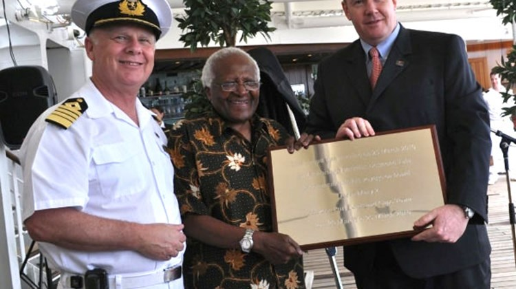 Archbishop Desmond Tutu, flanked by Captain Nick Bates and Cunard Line President Peter Shanks, commemorate the maiden call of the Queen Mary 2 in Cape Town, South Africa, on March 25.
