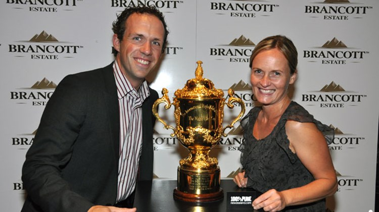 "Anderson Vacations' CEO Corey Marshall and Director of Product Karen McCardle were photographed in New Zealand with the Webb Ellis Trophy, more commonly referred to as ""the Rugby World Cup."""