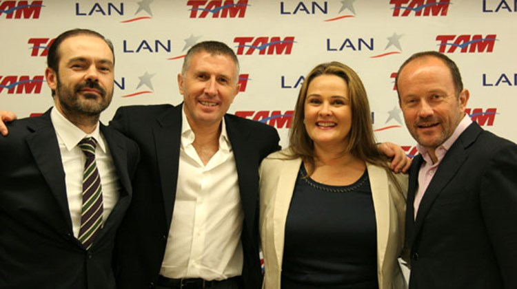 Family owners celebrate the signing of the MOU that outlines the intentions of Lan Airlines and Tam merge. (L-R): Mauricio Rolim Amaro, vice chairman of the TAM board of directors; Enrique Cueto, LAN CEO; Maria Claudia Amaro, chairman of the TAM board; and Ignacio Cueto, LAN president/COO.