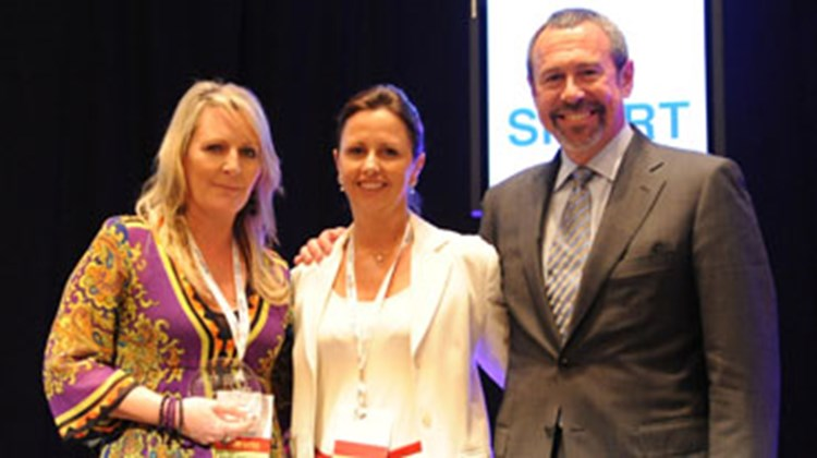 ACTE awards Aileen London, senior man., global meetings Asia Pacific, for Oracle Corp., with its President's Award. Pictured with London, Georgie Farmer, ACTE regional chair, Asia-Pacific and Asia travel manager, Microsoft Corp.; Ron DiLeo, executive director, ACTE.