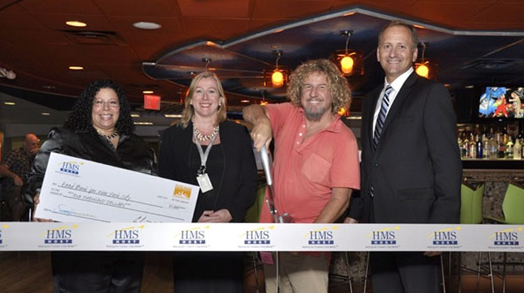 Sammy Hagar celebrates the grand opening of Sammy's Beach Bar & Grill at JFK's British Airways Terminal 7. Pictured (from left): Minerva Delgado, Food Bank for New York City; Maureen Borrell, British Airways; Sammy Hagar, The Hagar Family Foundation; and Joe Waller, HMSHost Corp.