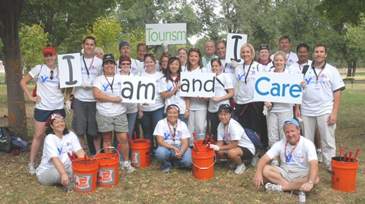 More than 25 Vacation.com employees participate in Tourism Cares for America Volunteer Day to paint park benches, posts and chains that line the walkways around key monuments along D.C.'s National Mall and Tidal Basin.