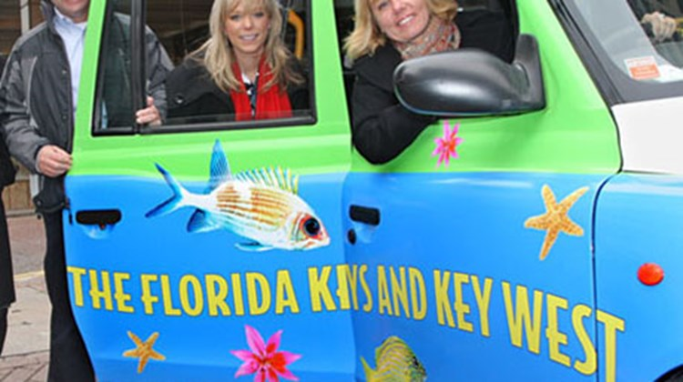 Posing with a Florida Keys & Key West-decorated taxi in London are Yves Vrielynck, Monroe County Tourist Development Council DSM; Lauren Sycamore, UK rep; and Stacey Mitchell, director of sales.
