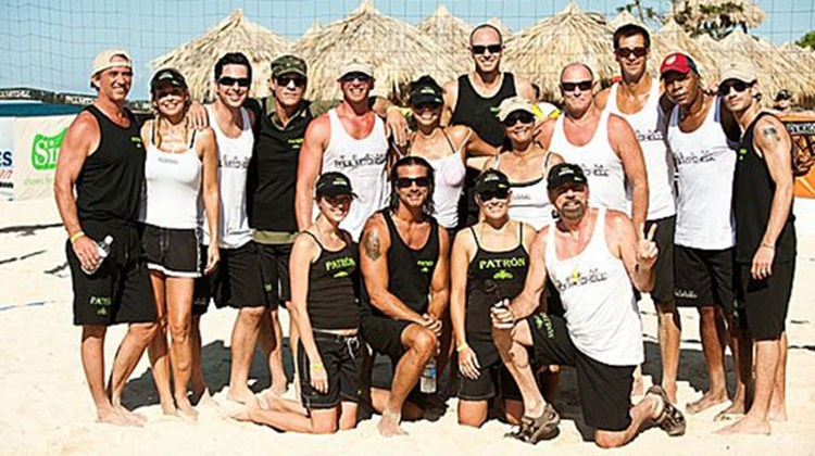 Celebrity teammates play a friendly game of volleyball at the Iberostar Jamaica Sports Invitational, hosted by Robert F. Kennedy, Jr. (first on left).