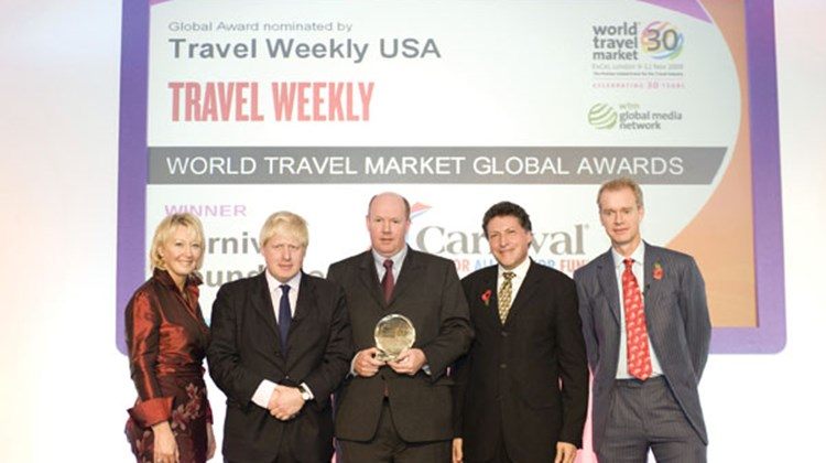 Peter Shanks, president of Cunard Line (middle) accepts a World Travel Market Global Award on behalf of the Carnival Foundation.