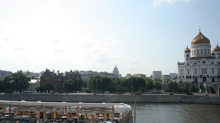 Moscow's famous Church of Christ the Savior in the background of the hip Strelka Bar across the Moscow River