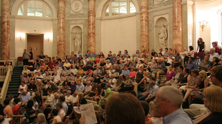Tourists fill the seats at the Hermitage Theatre in St. Petersburg for a ballet performance of Swan Lake
