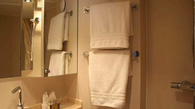 The bathrooms are equipped with a standing shower and L'Occitane products