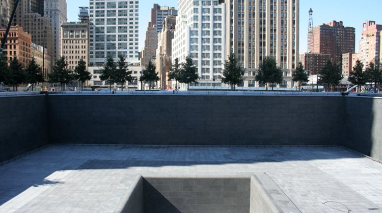 The 2,982 names of the people killed on 9/11 and Feb. 26, 1993, are inscribed on the perimeters of the memorial pools, set within the original footprints of the towers. Above, the south pool without water.
