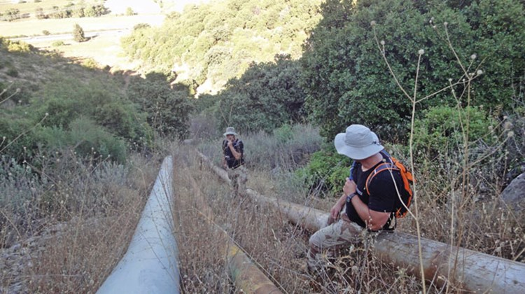 Kiesnoski, at bottom, and his brother hike their way up Mount Carmel in a LionOps endurance exercise, using a set of waterpipes to guide them up 1,200 feet