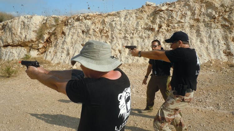At LionOps' West Bank training facility, learning to aim pistols...