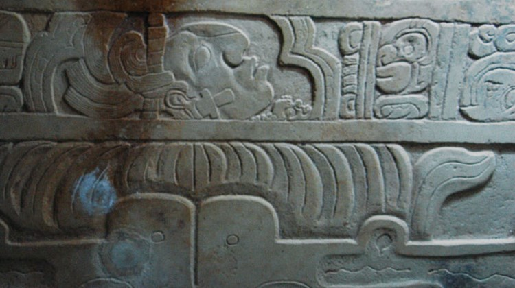 Carvings on the lid of the tomb within the Temple of Inscriptions in Palenque. TW photo by Arnie Weissmann