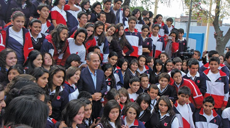 Calderon with high school students at his alma mater in Morelia. TW photo by Arnie Weissmann