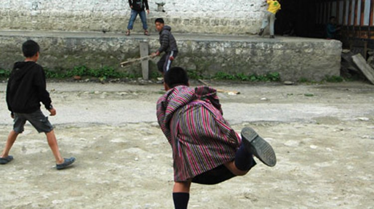 A pickup game of street cricket