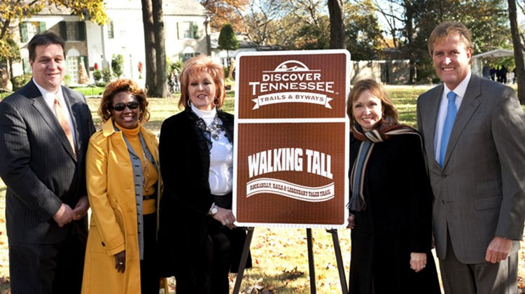 Celebrating the launch of the Walking Tall Trail at Graceland are (from l-r) Tennessee DOT rep Paul Degges; Shelby County rep Phyllis Fickling; Dwana Pusser, daughter of Sheriff Buford Pusser; Tennessee Commissioner of Tourist Development Susan Whitaker; and Memphis CVB President and CEO Kevin Kane.
