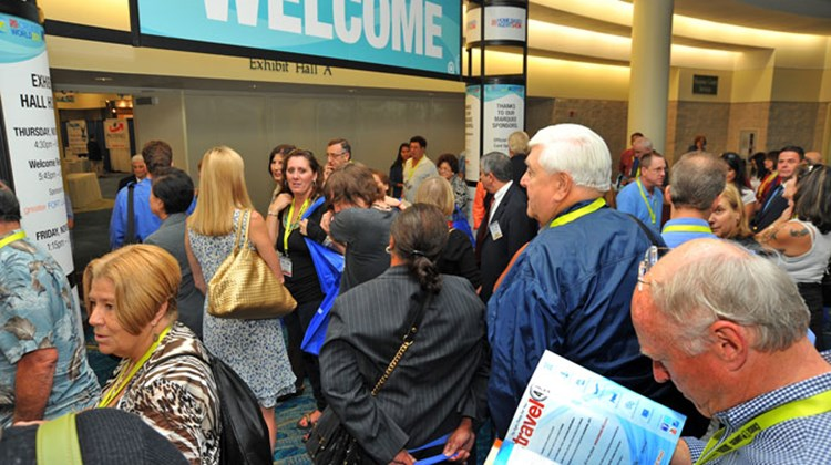 Delegates at the entrance to the trade show at CruiseWorld and the Home Based Agent Show and Convention