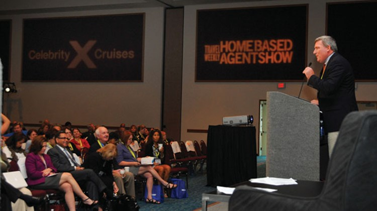 Bob Sullivan, Travel Weekly group publisher, addresses trade show attendees