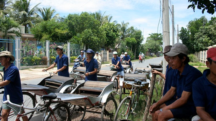 Rickshaws line up for Ama passengers in Tan Chau, Vietnam