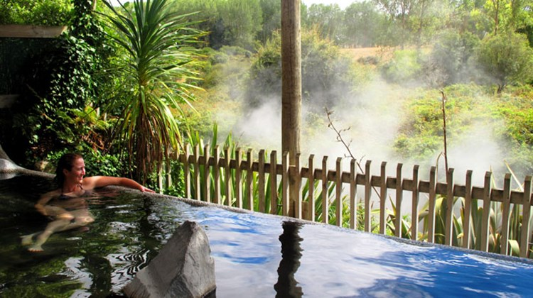 Rotorua is home to a range of geothermal pools where visitors can enjoy a relaxing soak. A bather enjoys the view from this public pool heated by the Te Manaroa spring, New Zealand's largest single source of naturally boiling water, at the Waikite Valley Thermal Pools facility.