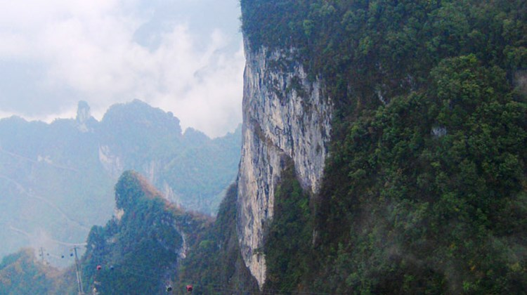 Visitors can journey up to Tianmen Mountain on board the longest mountain cableway in the world, traveling 4.5 miles from Zhangjiajie's city center to the limestone formation's peak.