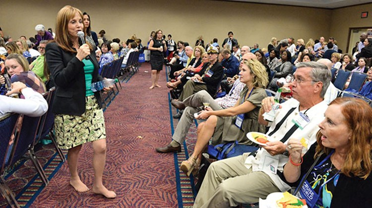 Vicki Freed of Royal Caribbean goes barefoot during the Think Tank