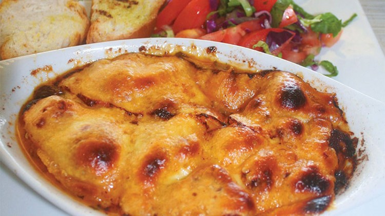 Keshi Yena is a classic Aruban meal. It consists of baked cheese stuffed with spiced meat