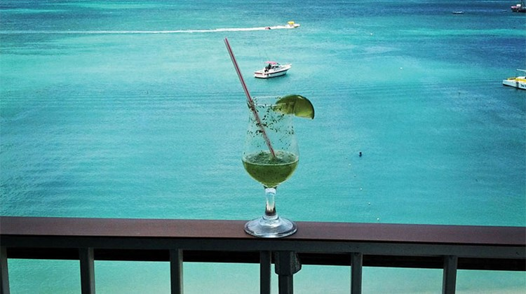 The staff at the Holiday Inn Resort Aruba greeted me with a delicious frozen mojito upon arrival, which I enjoyed while taking in my guestroom's balcony view