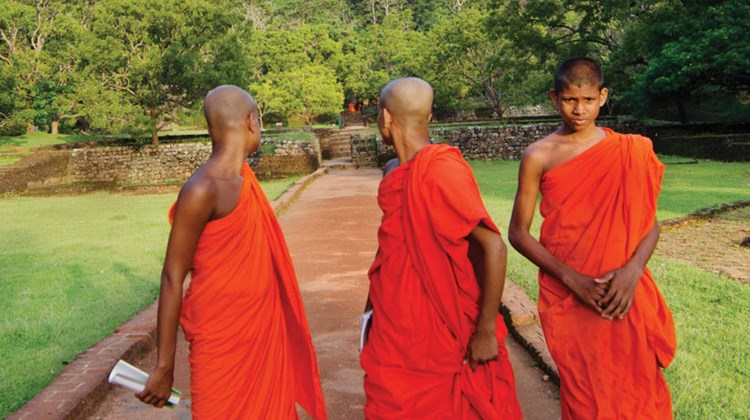 Some 70% of the population practice Buddhism and ancient temples and young monks are a common sight