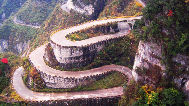 To reach Tianmen Cave, visitors must first travel by bus up a gravel road, climbing more than 3,600 feet in just under 7 miles while negotiating 99 turns. The number 9 has long been linked with good fortune in Chinese culture.