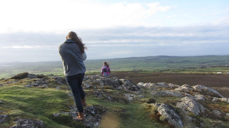 Owain Thomas' great-great-granddaughters take in the view from Mynyndd Bodafan, the mountain above Ty'n y Mynydd.
