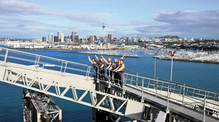 Thrill seekers can not only climb to the Auckland Harbour Bridge's summit, some 210 feet above the ocean, they can also dive off the massive steel structure. AJ Hackett Bungy offers bungee jumping from a platform beneath the bridge's eight lane highway, 130 feet above Waitemata Harbour. Photo courtesy of AJ Hackett Bungy
