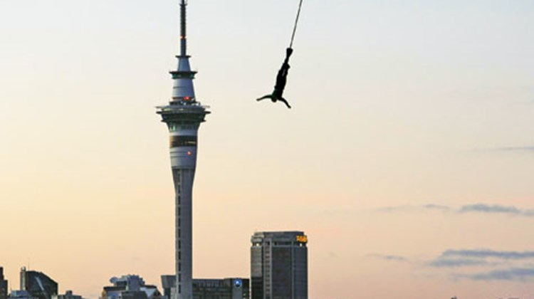 A jumper takes the plunge from the Auckland Harbour Bridge, with Auckland's Sky Tower in the distance. Photo courtesy of AJ Hackett Bungy