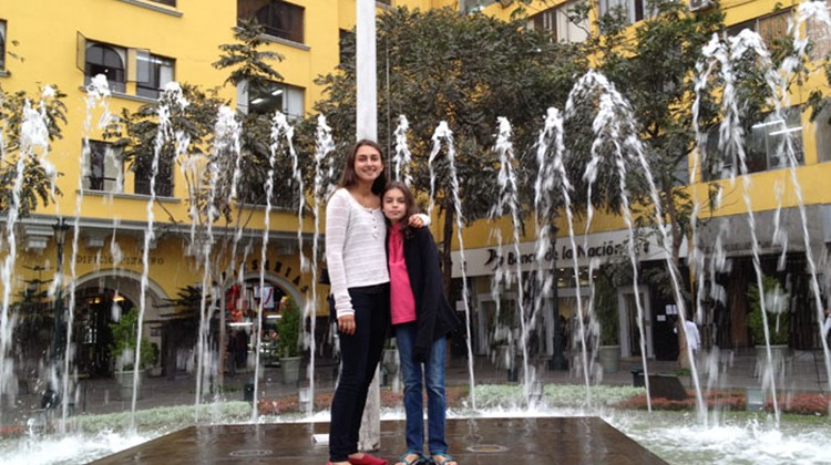 Touring sisters: Eliana and Gavriela Langer in front of a city fountain