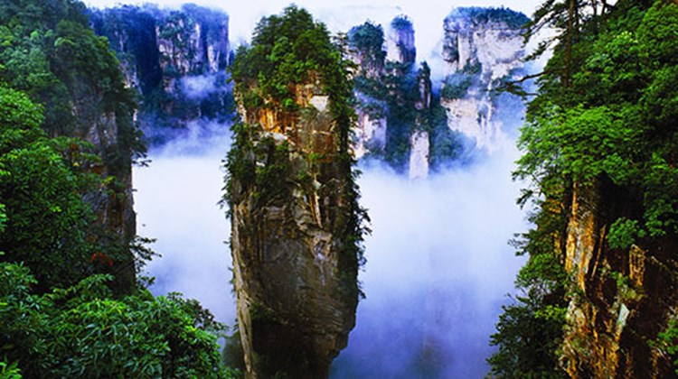 Regularly wreathed in low lying clouds, Yuanjiajie's quartz sandstone pillars inspired the floating islands of Pandora in the James Cameron film Avatar. Long known as Qiankun Zhu, the pictured formation has earned the more recent stage name of Avatar Mountain. Photo courtesy Zhangjiajie Tourism Bureau.