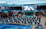 "The Carnival Splendor's midship pool area includes a giant movie screen and a retractable roof. CEO Gerry Cahill called the area an ""entertainment zone."""