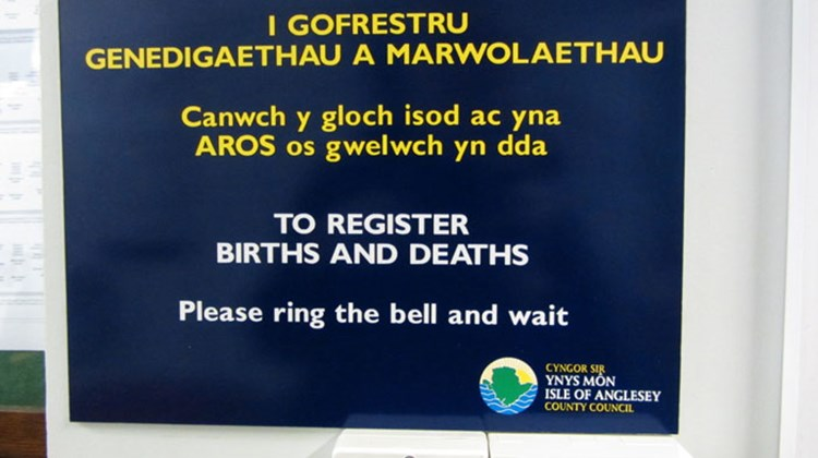 "We scramble down a narrow stairway to the basement, push open the door and find an empty room with a sign that says, in Welsh and English, to ""Please Ring the Bell and Wait."" So we do."