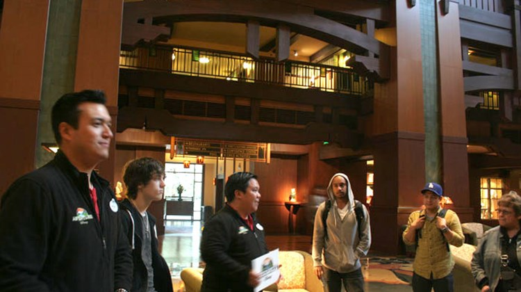 "Adventures by Disney tour guides Michael (left) and Christian greet the ""Lights, Camera, Magic!"" guests in the lobby of Disney's Grand Californian Hotel & Spa."