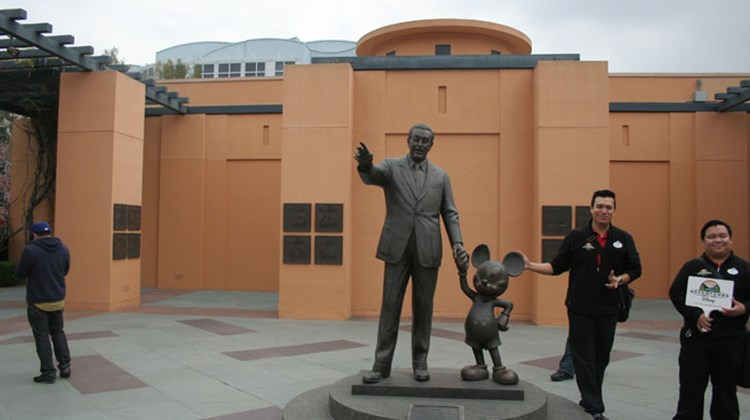 A statue of Walt Disney and Mickey Mouse at the studio lot.