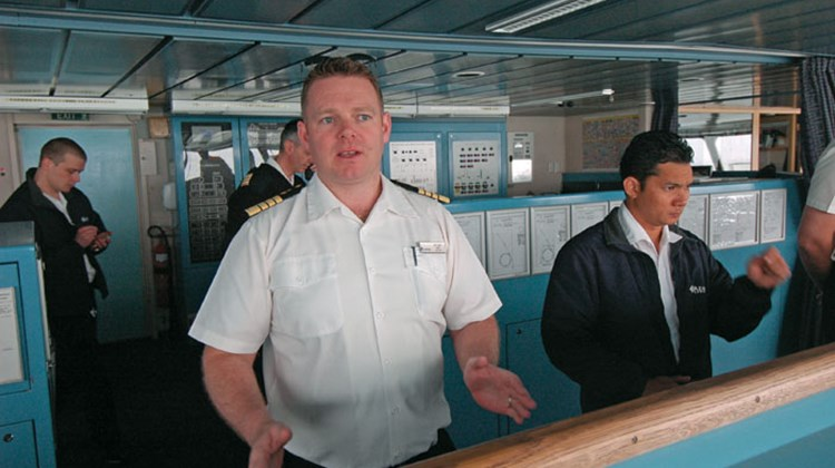 Capt. Carl Smith, left, contacted RCCL's emergency response team when he became aware of the earthquake and tsunami.