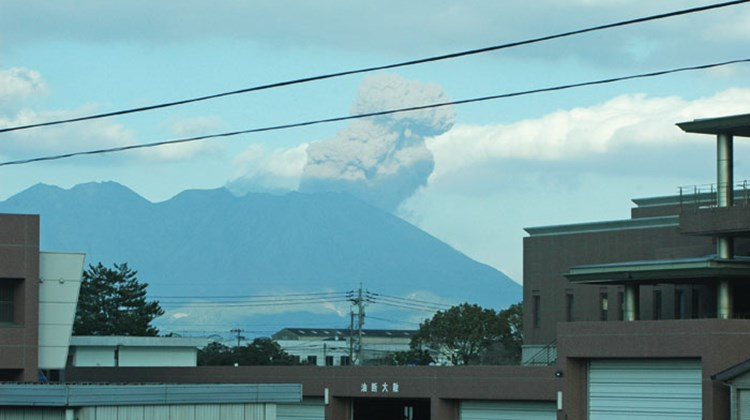 A column of smoke and ash rise from Mount Sakurajima, near Kagoshima, the day before the quake.