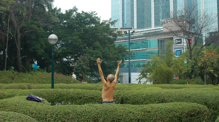 A Hong Kong resident performs Tai Chi in Kowloon Park.