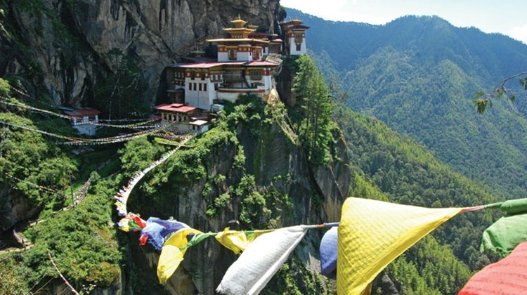 The Himalayan kingdom, located between India and China and east of Nepal, is pursuing 'high-value, low-impact' tourists as it aims to boost its visitor numbers fivefold next year. Pictured here, the Taktsang Monastery, also known as Tiger's Nest, in Paro Valley. TW photos by Arnie Weissmann