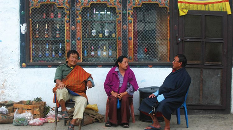 Three residents of Paro. The man on the right is wearing a gho, the national dress of Bhutan.