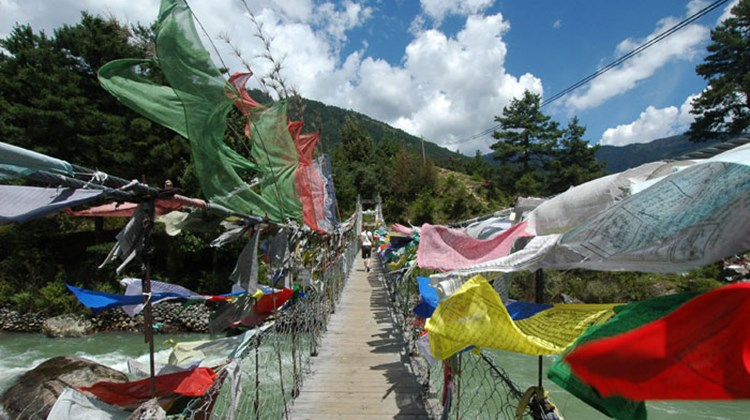 Prayer flags tied to a bridge in Bumthang region.